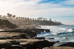 Windansea Beach Eroded Cliffs and Rock Formations. On a hazy morning in La Jolla, California Stock Images