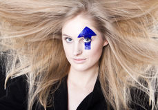 Windblown hair and arrow Royalty Free Stock Image