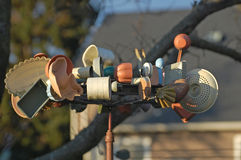 Windblown Whirligig made from kitchen items Royalty Free Stock Photography