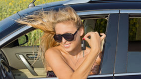 Windblown woman in car Royalty Free Stock Photos