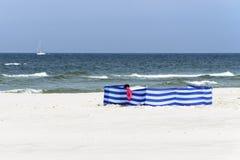 Windbreak on a wide golden beach at the Polish seaside. Blue windbreak on a wide golden beach at the Polish seaside Stock Photography