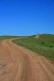 Windende weg op het groene gebied. Royalty-vrije Stock Afbeelding