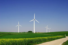 Windenergy 9. 4 moderen wind energy plants in rural area Royalty Free Stock Photography