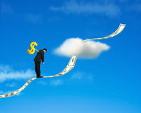Winder on businessman's back with money trend and sky backgound. Winder on businessman's back standing on growing money trend with cloud and blue sky background Stock Photography