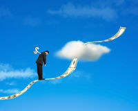 Winder on businessman's back with money trend and sky backgound. Winder on businessman's back standing on growing money trend with cloud and blue sky background Royalty Free Stock Photo