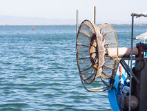 Winder fishing net. Particular of fisherman's boat Royalty Free Stock Photo