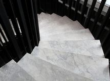 Winder, steps which are curved in plan. Winder with marble step Stock Images