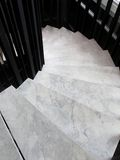 Winder, steps which are curved in plan. Winder with marble step Royalty Free Stock Photo