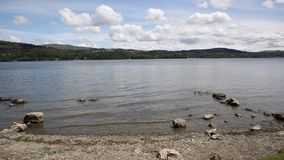 Windermere Lake District England uk with mountains PAN stock video