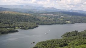 Windermere and Lake District mountains England uk from Gummers How with boat sailing stock video footage
