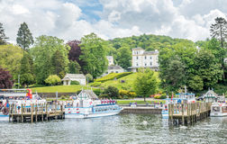 Windermere port with cruising boats Royalty Free Stock Photo