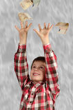 Windfall. Child taking euros falling from the sky like rain Royalty Free Stock Image