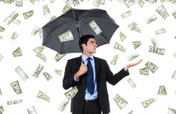 Windfall. Stock image of businessman with umbrella and falling money stock photos