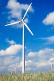 Windfarm on agricultural land. Wind turbines/ windfarm on farmland (slight motion blur on rotors Stock Image