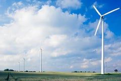 Windfarm on agricultural land. Wind turbines/ windfarm on farmland (slight motion blur on rotors Royalty Free Stock Photo