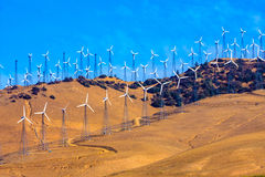 Windfarm on a bright sunny day Stock Images