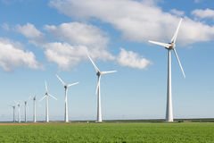 Windfarm in Dutch landscape with field of sugar beets Stock Image