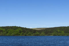 Windfarm and Lake in Summer Landscape Stock Image