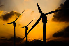 Windfarm in Norfolk, UK. Three wind turbines on a sunset background Stock Photography