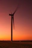 Windfarm på solnedgången Royaltyfria Bilder