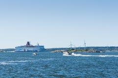 Windfarm and passenger ferry Gothenburg Stock Images