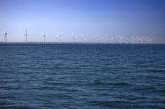 Windfarm a pouca distância do mar Fotografia de Stock