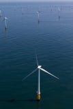 Windfarm a pouca distância do mar Imagem de Stock