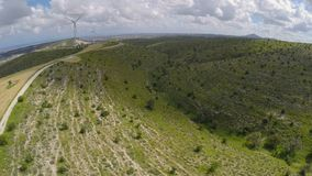 Windfarm producing alternative energy for city, electricity generation in Cyprus. Stock footage stock video