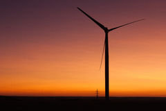 Windfarm at sunset and sky with dust from volcano Royalty Free Stock Photos