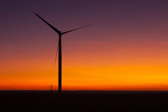 Windfarm at sunset and sky with dust from volcano Stock Images