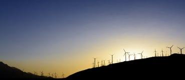 Windfarm at sunset Stock Photos