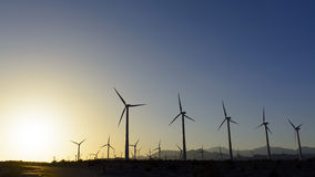 Windfarm at sunset Royalty Free Stock Photos