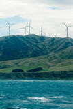 Windfarm wind turbines in mountain terrain Royalty Free Stock Photography