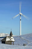 Windgenerator with a chapel Royalty Free Stock Images