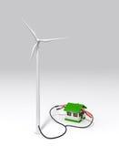Windgenerator lädt ein kleines Haus auf Stockfotografie