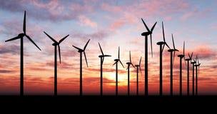 Windgeneratoren über orange Himmel lizenzfreie stockbilder