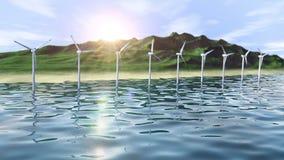 Windgeneratoren bewirtschaften im Ozean nahe einer Inselschleife stock footage