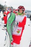 WINDHAM 12月19日-滑雪和骑马慈善的圣诞老人在Windham山 图库摄影