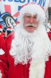 WINDHAM 19 de diciembre - esquí y montar a caballo Santas para la caridad en Windham Mountain. Fotos de archivo