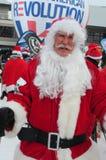 WINDHAM 19 de diciembre - esquí y montar a caballo Santas para la caridad en Windham Mountain. Foto de archivo libre de regalías
