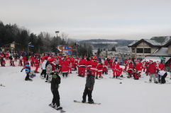 WINDHAM DECEMBER 19 - Skiing and Riding Santas for charity at Windham Mountain Royalty Free Stock Photos