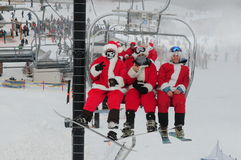 WINDHAM DECEMBER 19 - Skiing and Riding Santas for charity at Windham Mountain. Royalty Free Stock Photography