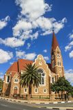 The classic German Lutheran Church of Christ in Windhoek in the setting of palm trees. One of the main attractions of the city stock photography