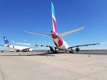 Planes at airport waiting to travel Royalty Free Stock Photo