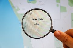 Windhoek, Namibia. Political map. City visualization illustrative concept on display screen through magnifying glass in the hand stock photography