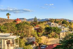 Windhoek rich resedential area quarters on the hills with mountains in the background, Windhoek, Namibia stock image