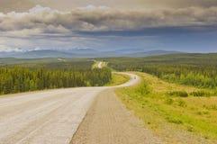 Winding Alaska highway. The winding Alaska highway in the Yukon, Canada, before Teslin royalty free stock image