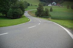 A winding asphalt road. Cross lines on road, Close up view of a road in curves stock photos