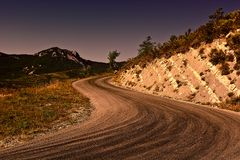 Road in French Alps. Winding Asphalt Road in the French Alps at Sunset Stock Image