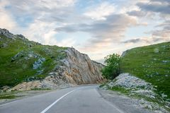 A winding asphalt road is located near Zabljak Stock Image